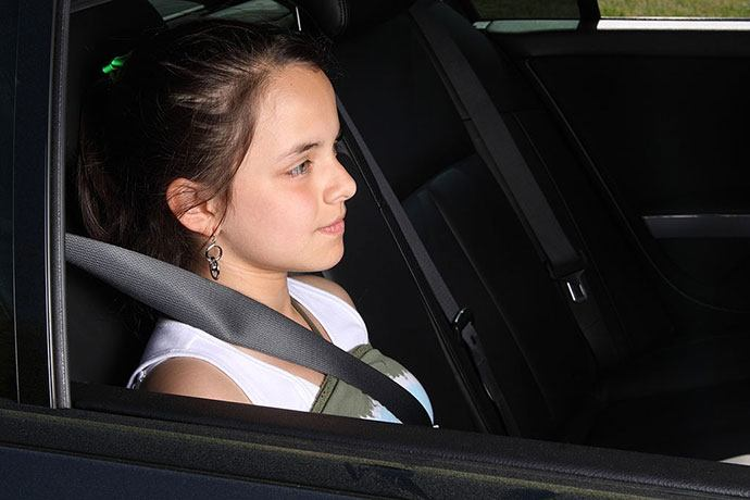 how do we keep tweens safely buckled in the back seat