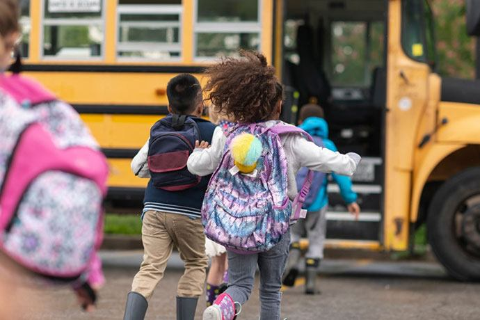 Why should I feel my child is safe riding in a school bus?