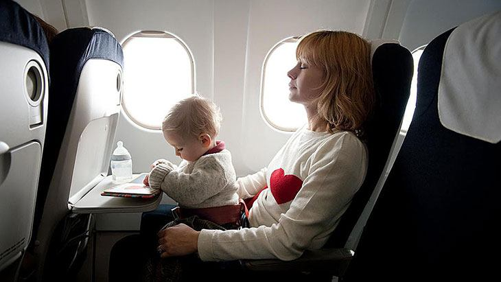 flying with infant on lap frontier