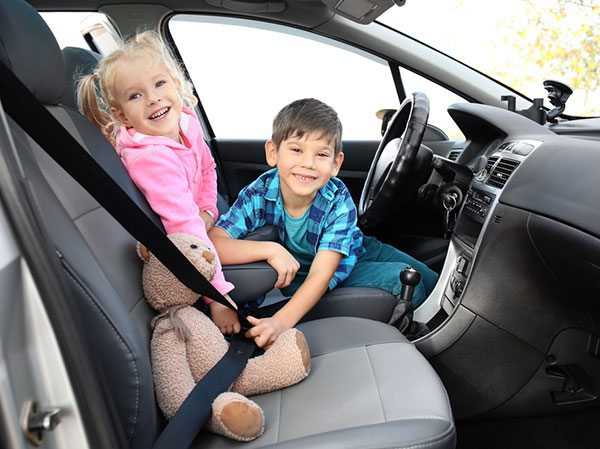 when can my child sit in the front seat