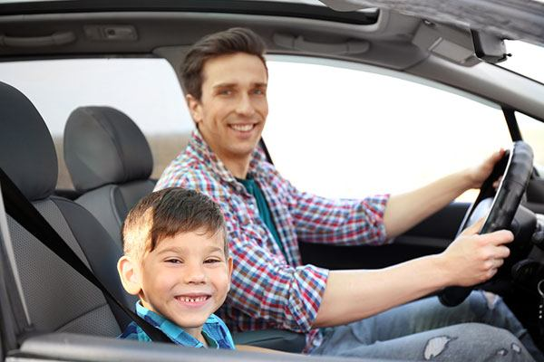 when can kid sit in the front seat